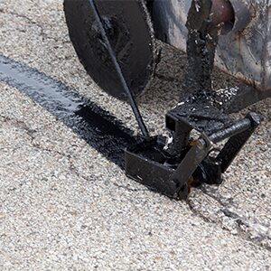 Crack repair on an asphalt driveway.